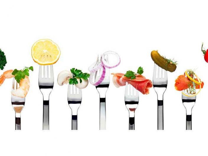 Different varities of food displayed in fork.