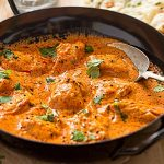 Chicken Butter Masala cooking in Cast Iron Pan